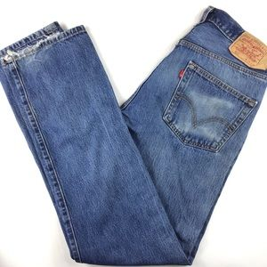 Faded Levi's 501 distressed high waisted mom dad